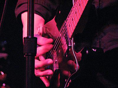 Marth Davis plays Guitar