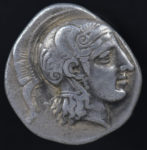 Pharsalos, Thessaly, Greece, 370-340 B.C.  Silver hemidrachm.  VF.  superb classical style, centered on a tight flan, marks, porosity, etched reverse, 2.886g, 16.3 mm, Pharsalos (Farsala, Greece) mint, 370-340 B.C.  Head of Athena right, wearing pendant earring and crested Altic helmet with raised cheek flaps, adorned with scrolls, hair out from under the neck guard. T (the master engraver Telephantos) over IIL (his apprentice?) behind neck.
